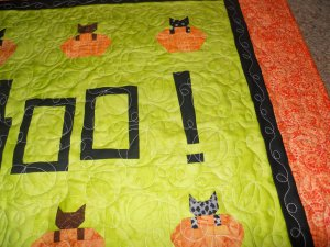 Close-up of pumpkin and vine quiltlng