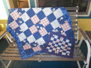 """Big and Little"" - a pair of charity quilts."